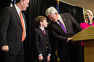 Newt Gingrich leans over to talk to his grandson Robert Cushman during a news conference announcing he is suspending his campaign for the Republican nomination for president on Wednesday, May 2, 2012 in Arlington, VA.