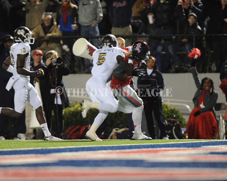 Ole Miss tight end Jamal Mosley (17) scores a touchdown as Mississippi State defensive back Nickoe Whitley (5) defends at Vaught Hemingway Stadium in Oxford, Miss. on Saturday, November 24, 2012. Ole Miss won 41-24.