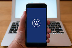 Logo of Westinghouse company on website on a smart phone