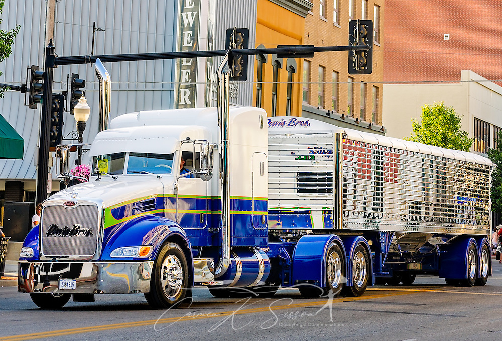 """""""Buzz Kill,"""" a 2015 Peterbilt 386 with a 2016 Wilson DH501 trailer, heads down Main Street during the 34th annual Shell Rotella SuperRigs parade, June 10, 2016, in Joplin, Missouri. SuperRigs, organized by Shell Oil Company, is an annual beauty contest for working trucks. Approximately 89 trucks entered this year's competition. """"Buzz Kill,"""" owned by Davis Bros., received the show truck award during the 2016 SuperRigs. (Photo by Carmen K. Sisson/Cloudybright)"""