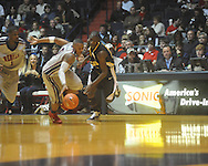 "Ole Miss guard Dundrecous Nelson (5)  steals the ball from Southern Mississippi forward Ahyaro Phillips (25) at C.M. ""Tad"" Smith Coliseum in Oxford, Miss. on Saturday, December 4, 2010. (AP Photo/Oxford Eagle, Bruce Newman)"