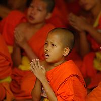 Monks praying at Wat Phra Kaeo Don Tao, Lampang, Thailand
