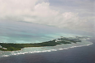 The islands of Kiribati in the South Pacific with their blue lagoon waters, seen through the clouds from an airplane, are endangered by rising sea water levels which are eroding the fragile atoll, home to approximately 92,000 people.