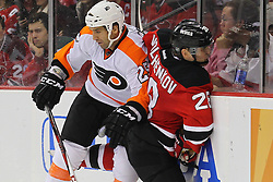Mar 13, 2013; Newark, NJ, USA; Philadelphia Flyers center Maxime Talbot (25) hits New Jersey Devils defenseman Anton Volchenkov (28) during the second period at the Prudential Center.