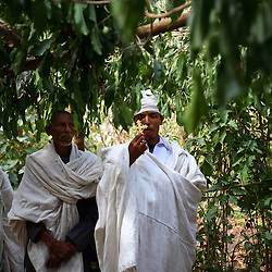 Priest Nigatu Alebachew peforms the marriage of Tsegaya Mekonen, 13, and Talema Meseret, 23, in Yeganda Village, Amhara Region, Ethiopia on May 20, 2007. The practice of early marriage remains widespread in Ethiopia, especially in the northern Amhara and Tigray regions, where parents consent to their daughters' consummated marriages when they are still as young as 10 or 12. In Amhara, 50 percent of girls are married by the age of 15, despite the enactment in 2000 of the revised Family Law, which sets the legal age for marriage at 18.