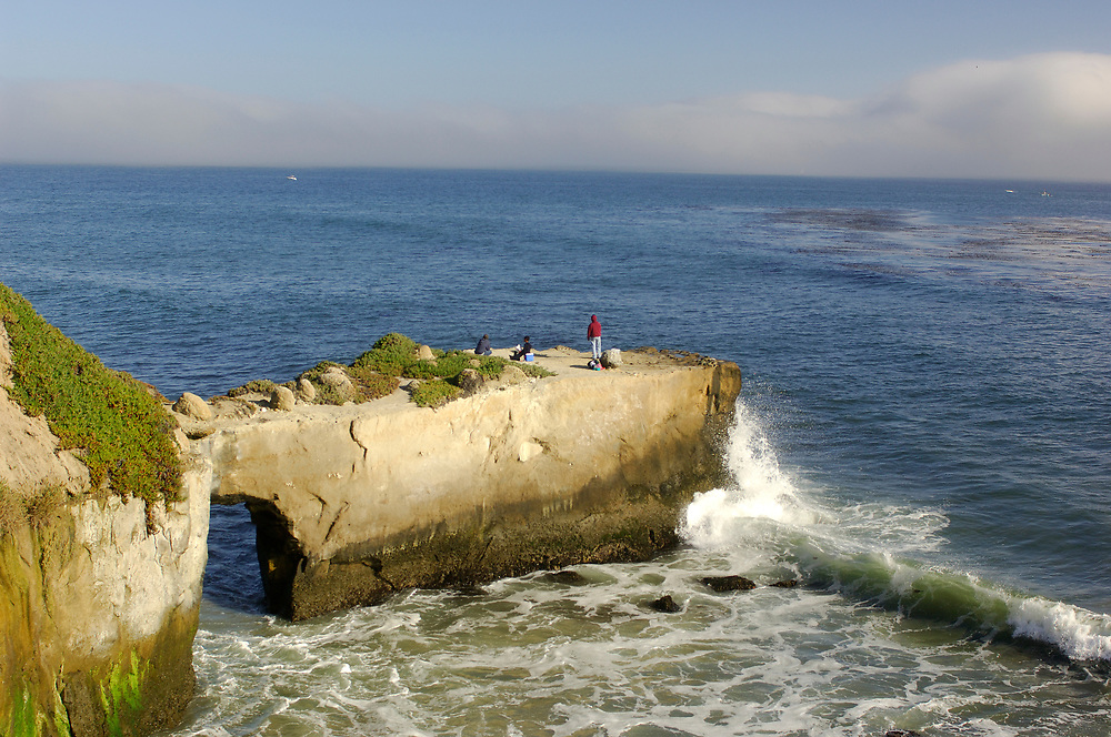 Fisher on coast, Lighthouse Field State Park, Santa Cruz, California, United States of America