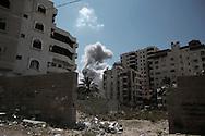 Gaza Strip, Gaza City:  Smoke rises after the impact of an Israeli airstrike Ansar neighbourhood in Gaza City, on August 9, 2012. ALESSIO ROMENZI
