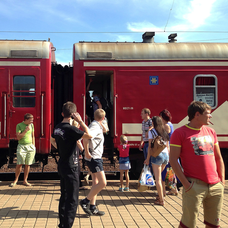 People board a train traveling from Donetsk to Moscow, away from areas with heavy fighting, on Monday, July 28, 2014 in Yasinovataya, Ukraine.