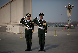 Officers of the People's Liberation Army (PLA) salutes on Tiananmen Square during the opening session of the National Peoples Congress (NPC) at the Great Hall of the People in Beijing, China, on 05 March 2011. The NPC has over 3,000 delegates and is the world's largest parliament or legislative assembly though its function is largely as a formal seal of approval for the policies fixed by the leaders of the Chinese Communist Party.