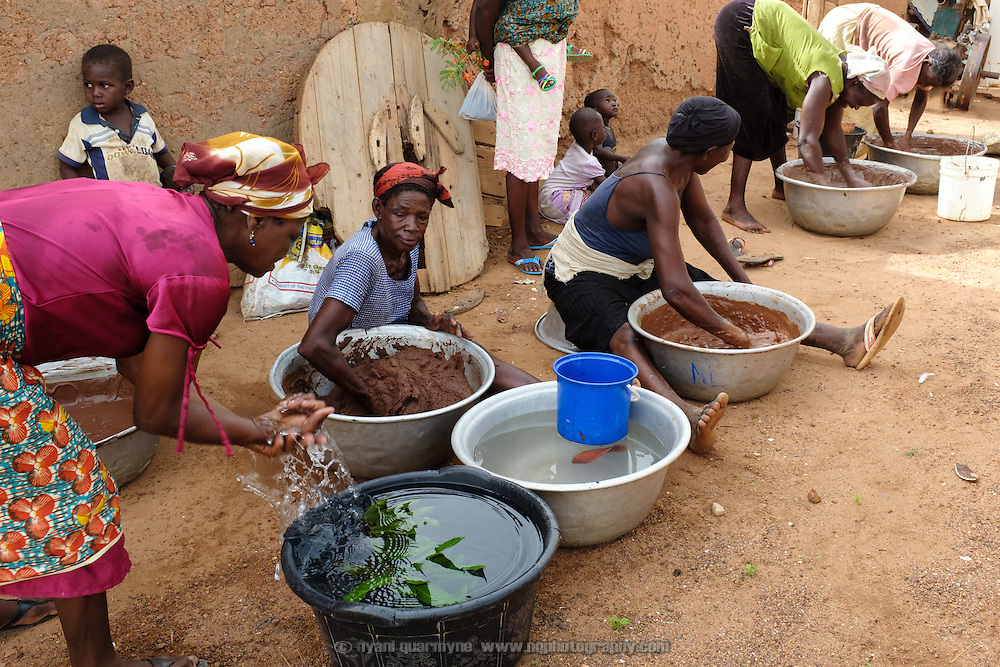Women making shea butter in the village of Lyssah in the Upper West region of Ghana. Though incredibly labour-intensive, shea butter production provides an important income stream for many women in the Upper West. The resulting butter is used for cooking as well as skincare.
