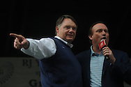 Ole Miss head coach Houston Nutt (left) and host Tim Brando during Grove Bowl pre-game activities in the Grove at the University of Mississippi in Oxford, Miss. on Saturday, April 17, 2010.