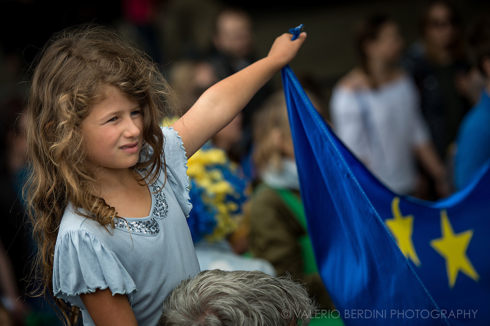 A child takes part in the protest, likely today's children will be the affected people in the consequences of UK outside EU. Tens of thousands of people marched in central London on 2nd of July protesting against the results of the Referendum that called UK outside the European Union.