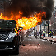 WASHINGTON, USA - January 20: Anti-Trump protestors set a limousine on fire during clashes with police after President Trump was sworn into office in Washington, USA on January 20, 2017.