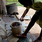 Kipushi, DRC. March 2009. A project was created with the support of UNICEF to encourage children, especially girls to attend school and further their education. In a town that relied heavily on mining activity, it was devastating when state-owned Gecamine ceased operating in 1993 as a result of financial problems. Children and women were forced to break up stones in the discarded wastelands of the mines, to earn an income.