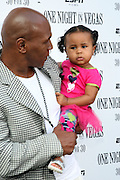 31 August 2010- New York, NY- Mike Tyson, daughter Milan Tyson and Guest arrive at the screening of ' One Night in Vegas ' held at The Dwyer Cultural Center on August 31, 2010 in the Village of Harlem, New York City.