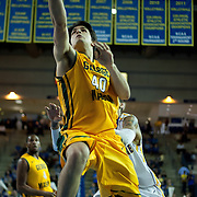 George Mason Forward Marko Gujanicic (40) drives to the hoop in the first half of a regular season NCAA basketball game against George Mason Saturday, March 2, 2013 at the Bob Carpenter Center in Newark Delaware.
