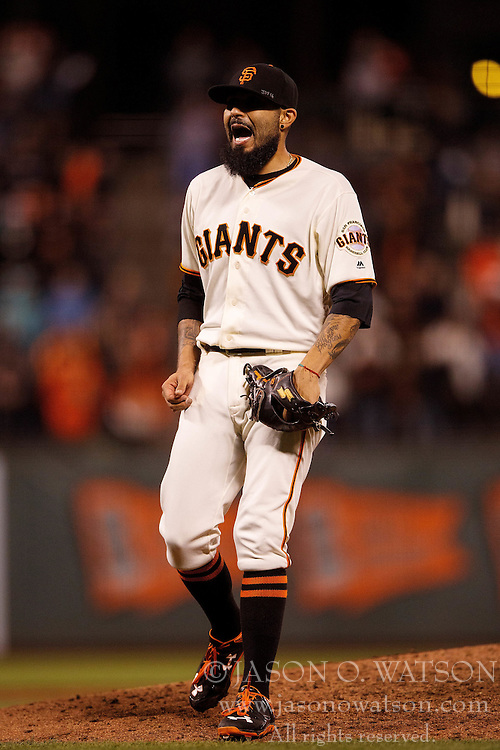 SAN FRANCISCO, CA - SEPTEMBER 29:  Sergio Romo #54 of the San Francisco Giants reacts after a pitch against the Colorado Rockies during the ninth inning at AT&T Park on September 29, 2016 in San Francisco, California. The San Francisco Giants defeated the Colorado Rockies 7-2. (Photo by Jason O. Watson/Getty Images) *** Local Caption *** Sergio Romo