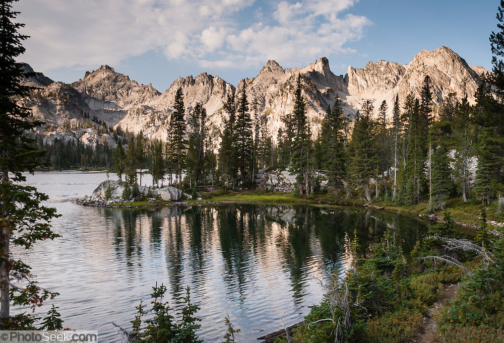 Alice Lake (8598 feet elevation) in Sawtooth Wilderness, Blaine County, Idaho, USA. The Sawtooth Range (part of the Rocky Mountains) are made of pink granite of the 50 million year old Sawtooth batholith. Sawtooth Wilderness, managed by the US Forest Service within Sawtooth National Recreation Area, has some of the best air quality in the lower 48 states (says the US EPA).