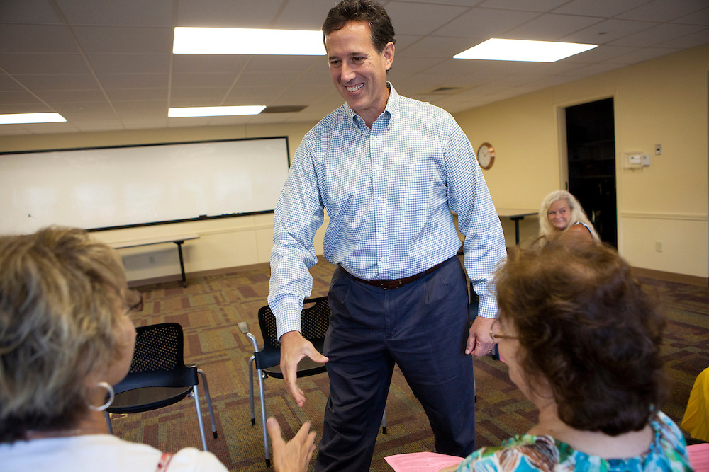 Republican presidential hopeful Rick Santorum shakes hands with guests at a campaing stop on Thursday, July 28, 2011 in Fort Madison, IA.