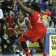 Delaware Center Kelsey Buchanan (13) drives to the basket as St. John's Forward Amber Thompson (2) defends in the first half of a NCAA regular season non-conference game between Delaware (CAA) and St. John's (Big East) Monday, Dec 30, 2013 at The Bob Carpenter Sports Convocation Center in Newark Delaware.
