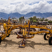 Old yellow road grader at the Eastern California Museum, 155 N. Grant Street, Independence, California, 93526, USA. The Museum was founded in 1928 and has been operated by the County of Inyo since 1968. The mission of the Museum is to collect, preserve, and interpret objects, photos and information related to the cultural and natural history of Inyo County and the Eastern Sierra, from Death Valley to Mono Lake.