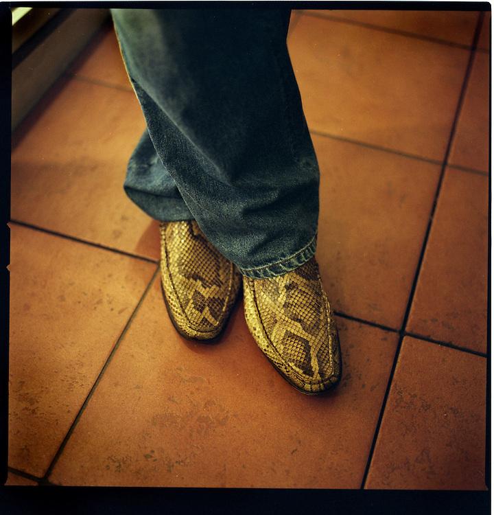 Kyosuke Akitsu's snake skin Loafers.  Aktsu is a gal-O gigolo. Women pay him for his sexual services and companionship, Setagaya Ward, Tokyo, Japan.