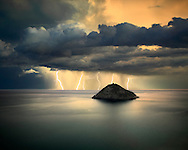 """A mighty thunderstorm off the Ligurian coast near Bergeggi, Italy. This is a multiple exposure consisting of 5 shots of 15"""", each with at least a bolt in it. Taken from a vertical cliff about 100 meters above the sea level, on a evening of November, a few minutes after sunset. Notes about the technique: I initially took a single exposure of 90"""" of the same scene, with more or less  the same number of lightning bolts in it. Unfortunately with 75"""" of exposure the clouds were badly blurred, and that's the reason why I opted for taking a number of faster exposures to be combined together. I noticed that the lightnings had quite a regular pace - more or less one every 10"""" - so I simply realized that by keeping the shutter open for 15"""", I would have easily recorded at least one bolt on each exposure. I did this for about 12 times, and then I chose the best 5 images to be stacked together. With this """"trick"""", I've been able to produce an image with more or less the same number of bolts as the one exposed by 75"""", but with the clouds far less blurred. ."""