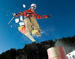 NEWS&GUIDE PHOTO / PRICE CHAMBERS.Local shredder Charlie Hawks, 17, takes off from a jump at Jackson Hole Moutain Resort on Saturday, opening day for the season. Despite the area's lack of snowfall the ski area is blowing enough of the white precipitate to open Apres Vous and Teewinot lifts and has constructed two small terrain parks with several jumps and rails.