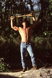 muscular man holding an ax over his head