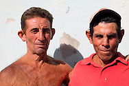 Two brothers in Caletones, Holguin Province, Cuba. Caletones was destroyed by a hurricane a few years ago.