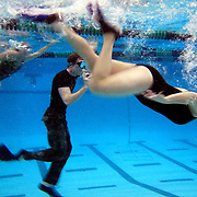 Instructor Justin Bradshaw, wearing camouflage pants, leads a game of underwater football at the end of his Aquatic Boot Camp at Carroll I.S.D. Aquatics Center in Southlake, Texas.