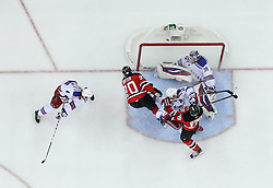 May 25, 2012; Newark, NJ, USA; New Jersey Devils center Ryan Carter (20) scores a goal on New York Rangers goalie Henrik Lundqvist (30) during the first period in game six of the 2012 Eastern Conference finals at the Prudential Center.