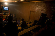 Residents watch films at a makeshift movie house in the Kibera slum of Nairobi, Kenya June , 2008.Kibera is home to nearly 1million people living in an area roughly the size of New York's Central Park with sprawling market places and  PHOTO BY KEITH BEDFORD