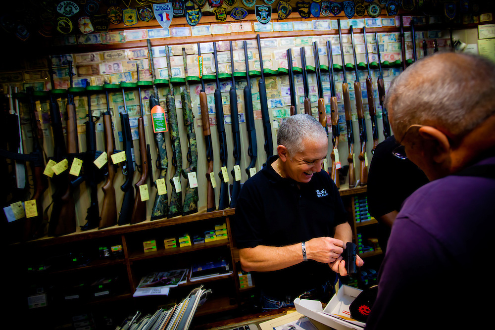 DAYTONA BEACH, FL -- Scott Buckwald, owner of Buck's Gun Rack, helps a customer at his shop in Daytona Beach, Fla., on Friday, January 27, 2012. As the Florida Primary approaches, the voters along the I-4 corridor are becoming an increasingly more important path to securing a win.  (Chip Litherland for The New York Times)