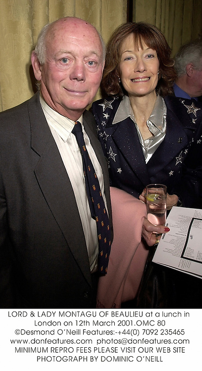 LORD & LADY MONTAGU OF BEAULIEU at a lunch in London on 12th March 2001.		OMC 80