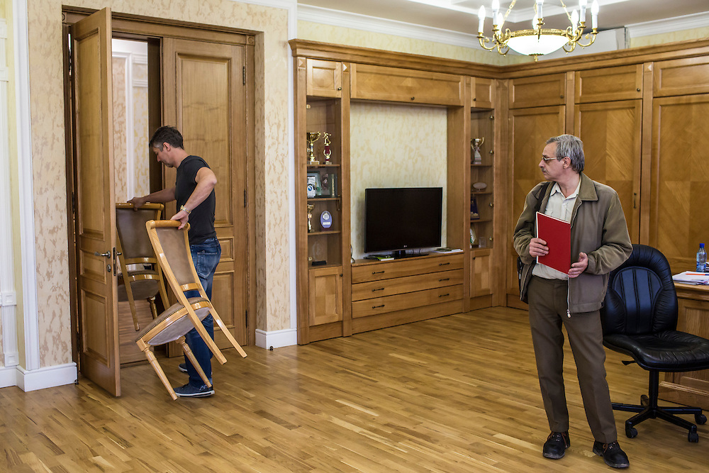 YEKATERINBURG, RUSSIA - OCTOBER 17: Yekaterinburg Mayor Yevgeny Roizman carries chairs from his office to the reception area for waiting constituents on October 17, 2013 in Yekaterinburg, Russia. Roizman was elected mayor of Yekaterinburg, Russia's fourth-largest city, in a surprise victory in September based on a platform of anti-corruption and his local notariety for founding a popular anti-drug addiction program called City Without Drugs. Widely seen as politically opposed to Vladimir Putin, Roizman is the highest placed opposition figure in public office in Russia. (Photo by Brendan Hoffman/Getty Images) *** Local Caption *** Yevgeny Roizman