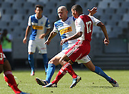 CAPE TOWN, South Africa - Saturday 26 January 2013, Ibrahim Samardzic of Grasshopper Club Zurich is challenged by Toriq Losper of Ajax Cape Town during the soccer/football match Grasshopper Club Zurich (Switzerland) and Ajax Cape Town at the Cape Town stadium..Photo by Roger Sedres/ImageSA