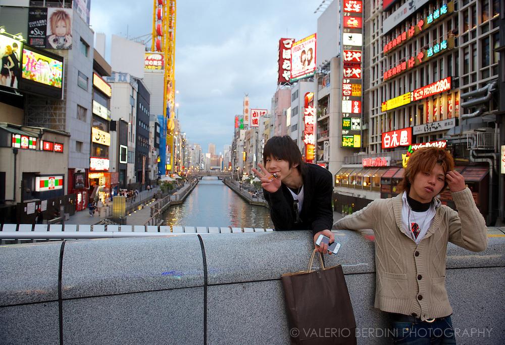 Two boys hang around hikkakake-bashi, pick-up bridge, in Osaka. Japan 2013