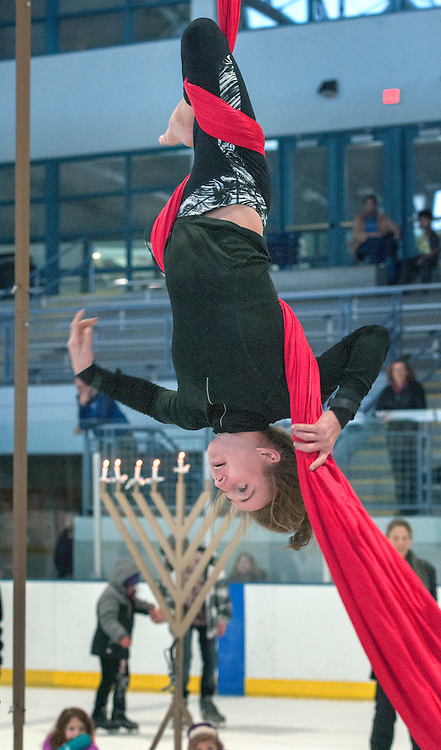 em122716d/metro/Heather Haggerty, from Salida, Co., performs a trapeze act during Chanukah on Ice at the Genoviva Chavez Community Center in Santa Fe,  Tuesday December 27, 2016.   (Eddie Moore/Albuquerque Journal)