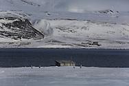 Coastal hut in Colesbukta in April between Longyearbyen and Barentsburg; Svalbard, Norway.
