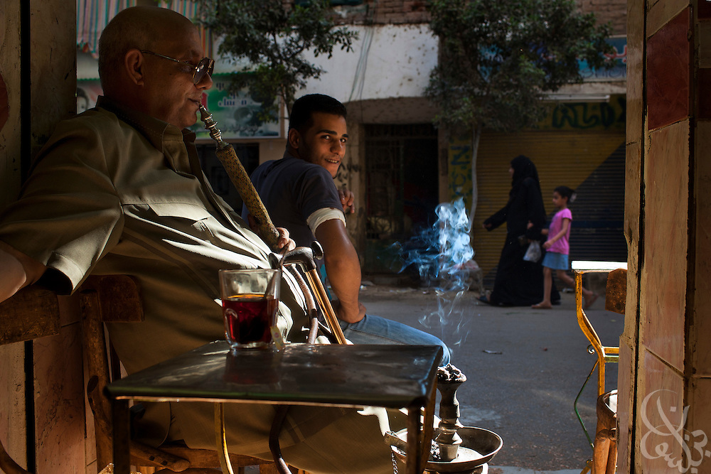 An Egyptian man smokes a water pipe in the working class Cairo neighborhood of Imbaba, Egypt July 16, 2011. Crime, unemployment and inflation have continued to rise in post-revolutionary Egypt. (Photo by Scott Nelson))