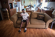 BEAUFORT, SC - JULY 14: Like most 14-year-olds, CJ Cummings spends time in front of a television in his spare time before his weightlifting coach picks him up for practice on July 14, 2014 in Beaufort, South Carolina. Cummings, who is 5-foot-2, is part of a resurgence of interest in Olympic weightlifting in the U.S. (Photo by Stephen B. Morton for The Washington Post)