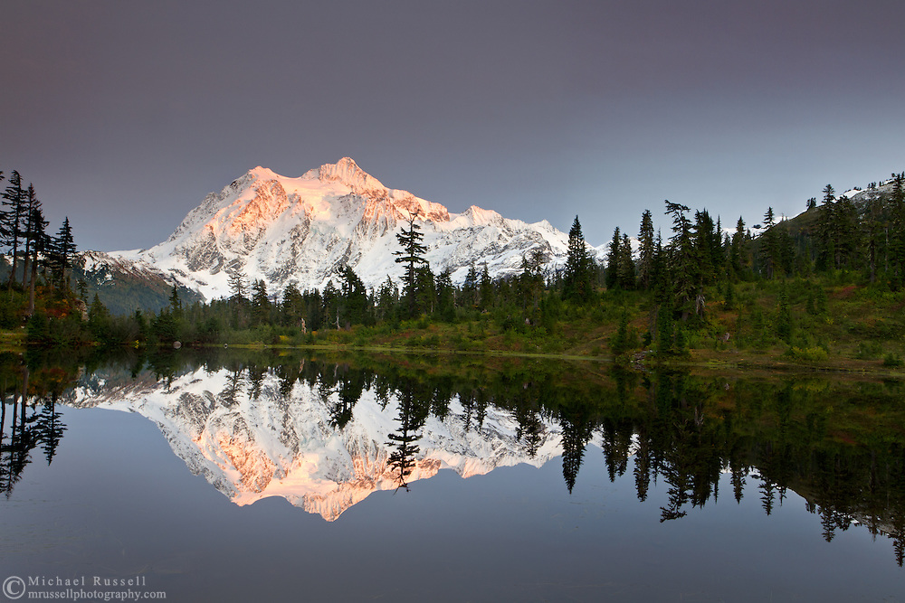 Alpenglow on Mount Shuksan andthe Fall colors at  Picture Lake in the Mount Baker-Snoqualmie National Forest, Washington State, USA