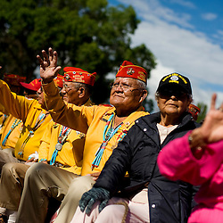 081309   Brian Leddy.Guy Clauschee and several other Navajo Code Talkers wave at passerby during a parade honoring their achievements on Friday morning.