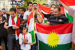 """London, August 13th 2014. Dozens of London's Kurdish and Yazidi community demonstrate outside the gates of Downing Street against the unfolding genocide against their people in Iraq by terror organisation ISIS, now known as the """"Islamic State""""."""