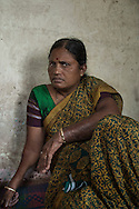 India, Maharashtra. Anita, 42yo, was married to an alcoholic who kept asking money until one day he burned her. <br /> Fortunately Anita didn't die of her burns and decide after this to became a social activist against alcoholism. <br /> Alessio Romenzi