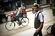 Sunil Babu Pant, an openly gay member of Nepal's parliament and founder of the Blue Diamond Society,walks through the streets in Kathmandu, Nepal July 23, 2009. Photo by Keith Bedford