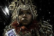 Rio de Janeiro, RJ, Brazil, 07/03/2011, 21h24:  As her samba school loses points due to its retardation, a samba dancer cries in Rio de Janeiro's 2011 Carnival, at Marquês de Sapucaí avenue.  (photo: Caio Guatelli)