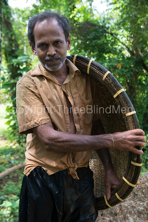 Premaratne, gem miner. Gem mining in the Eheliyagoda area.