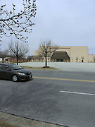 Owings Mills Mall was developed by James Rouse and his company, the Rouse Company in 1986. It lost Boscov`s department store at one of its anchor positions in October 2008.  This photo shows one of two emptry parking lots in front of the three closed store entrances.  The mall itself lost many stores, numbering more than 30, and the corridor leading to the old Boscov`s spot was left with only a few stores remaining open.